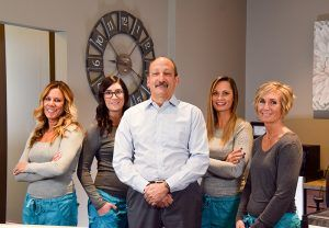 Our dentist, Dr. Peter Lo Destro, and office team